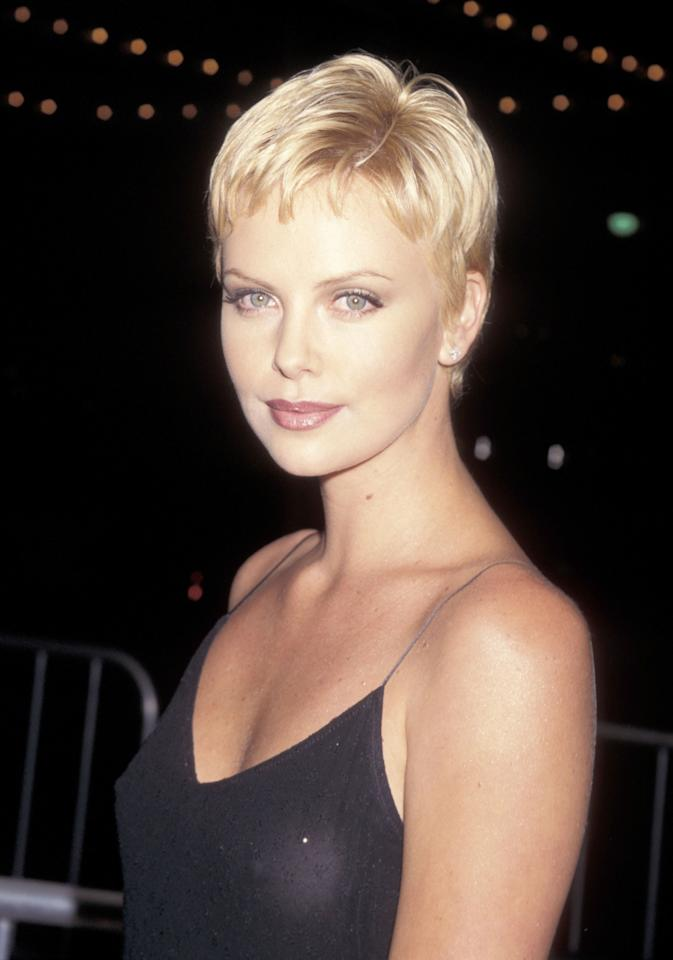 <p>Debuting her pixie cut with a subtle cat eye and a glossy mauve lip, Theron arrives at the <em>Mad City</em> Los Angeles premiere. (1997)</p>