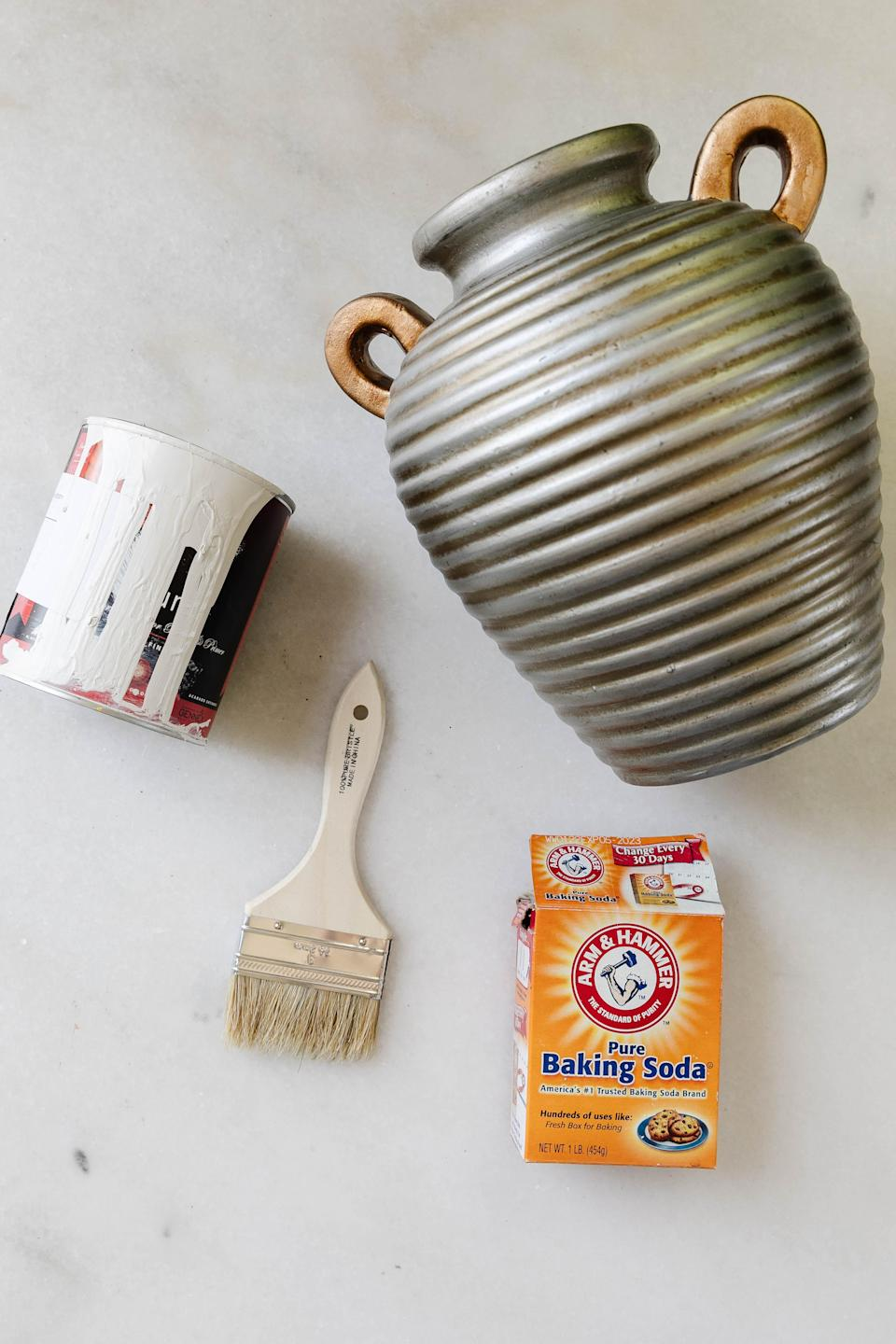 Gather your materials: baking soda and household paint.