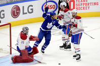 Toronto Maple Leafs' John Tavares (91) celebrates after scoring on Montreal Canadiens goaltender Carey Price (31) during the first period of an NHL hockey game in Toronto, Wednesday, Jan. 13, 2021. (Frank Gunn/The Canadian Press via AP)