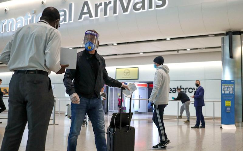 Passengers arriving at Terminal 2 at Heathrow Airport in London, as new quarantine measures for international arrivals came into force in June - PA