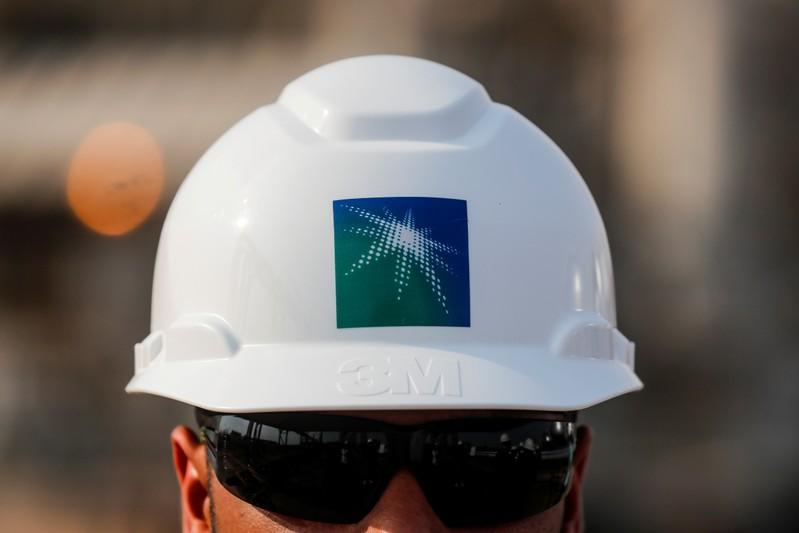 FILE PHOTO: FILE PHOTO: An employee in a branded helmet is pictured at Saudi Aramco oil facility in Abqaiq