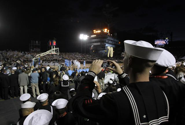 CORONADO, CA - NOVEMBER 11: U.S. Military personnel watch the North Carolina Tar Heels play against the Michigan State Spartans during the Quicken Loans Carrier Classic on board the USS Carl Vinson on November 11, 2011 in Coronado, California. (Photo by Ezra Shaw/Getty Images)