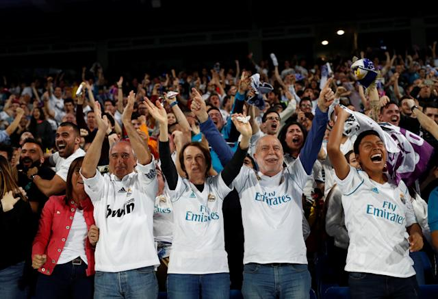 Soccer Football - Real Madrid fans watch the Champions League Final - Madrid, Spain - May 26, 2018 Real Madrid fans celebrate after their first goal while watching the match inside the Santiago Bernabeu REUTERS/Javier Barbancho