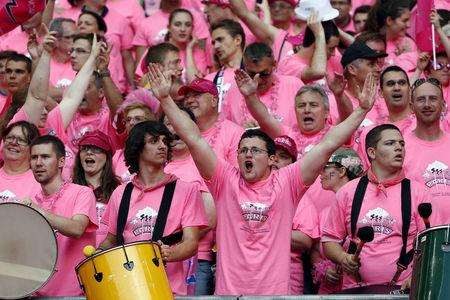 FILE PHOTO: Stade Francais supporters cheer for their team during the French rugby union final match against ASM Clermont Auvergne at the Stade de France stadium in Saint-Denis, near Paris