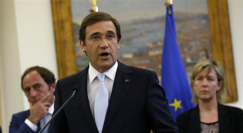 Portugal's Prime Minister Pedro Passos Coelho makes a statement accompanied by his ministers at St Bento Palace in Lisbon