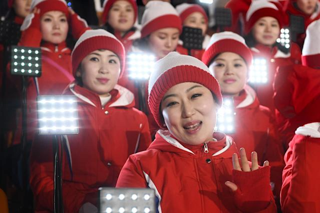 <p>Members of the North Korean cheering band wave ahead of the opening ceremony of the Pyeongchang 2018 Winter Olympic Games at the Pyeongchang Stadium on February 9, 2018. </p>