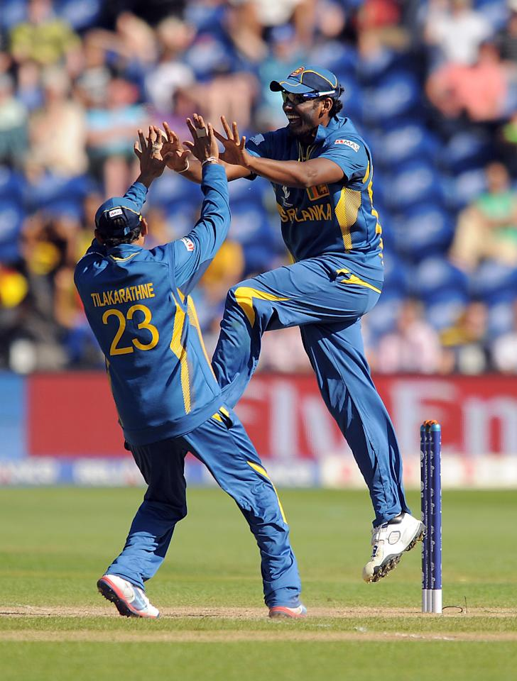 Sri Lanka's Thisara Perera (right) celebrates with team mate Tillakaratne Dilshan after running out New Zealand's Kyle Mills (not pictured) during the ICC Champions Trophy match at the SWALEC Stadium, Cardiff.