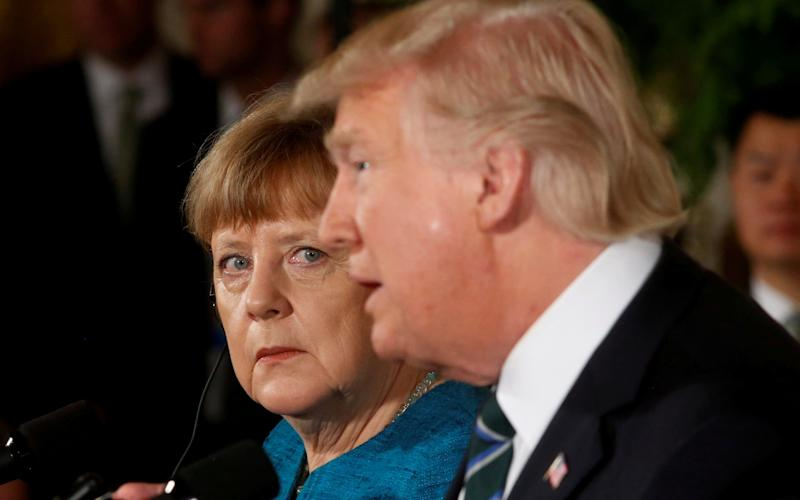Angela Merkel and Donald Trump speak at a White House press conference - Jonathan Ernst/Reuters