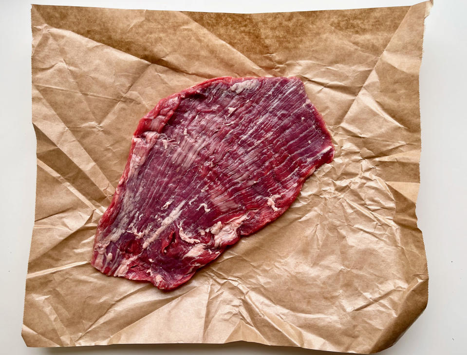 Try to find a flank steak that is as evenly sized as possible so that it cooks as evenly as possible. (Ali Rosen)