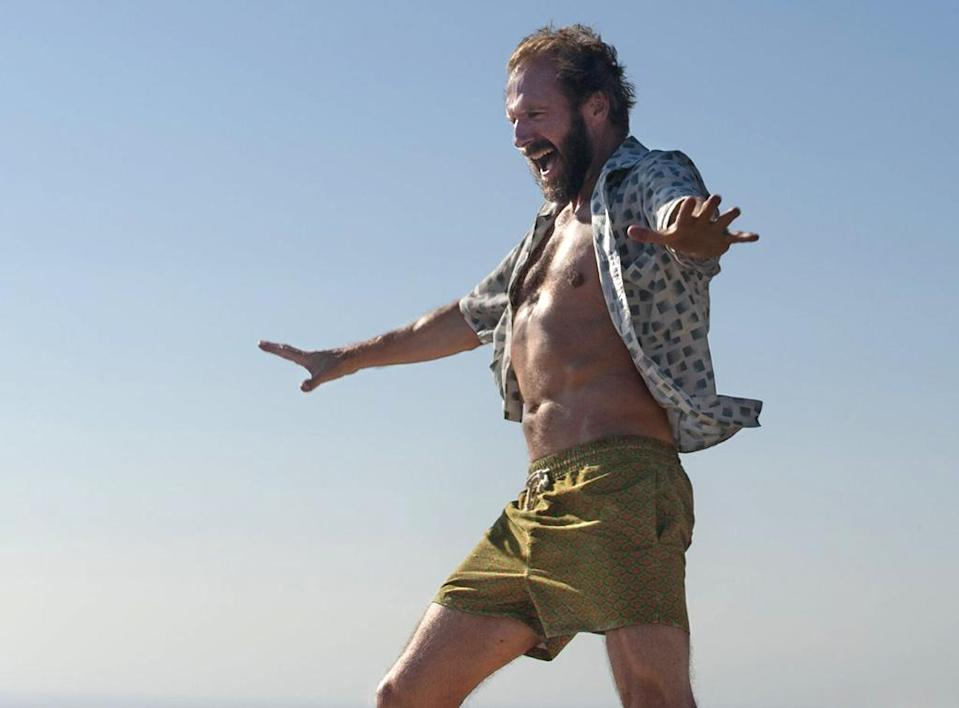 <p>Playing a human tornado of unbridled sexuality, resentment, ego, sorrow, and despair, Fiennes steals every one of his scenes in Luca Guadagnino's under-heralded drama, in the process reconfirming his status as one of modern cinema's most versatile, and charismatic, actors. (Photo: Fox Searchlight) </p>