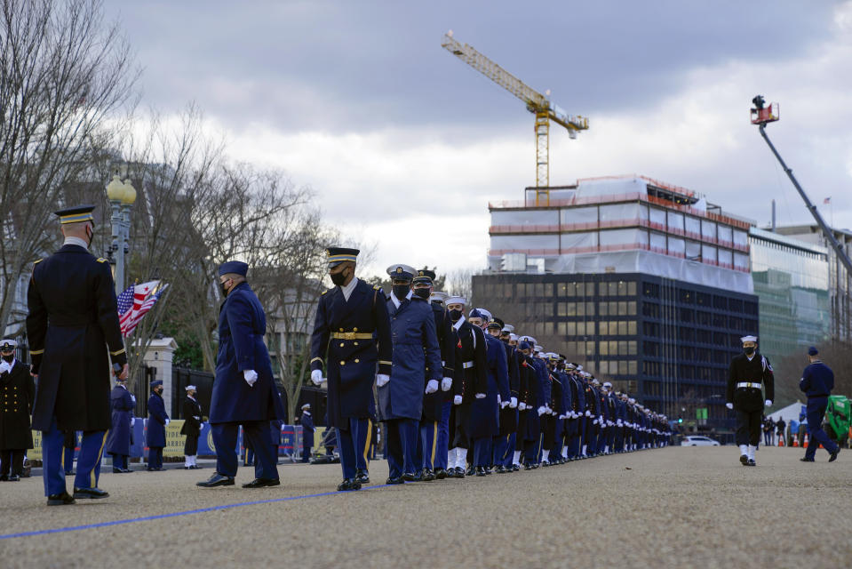 Members of the military march in formation on Pennsylvania Avenue in front of the White House in Washington, as they rehearse ahead of President-elect Joe Biden's inauguration ceremony, Monday, Jan. 18, 2021. (AP Photo/Pablo Martinez Monsivais)