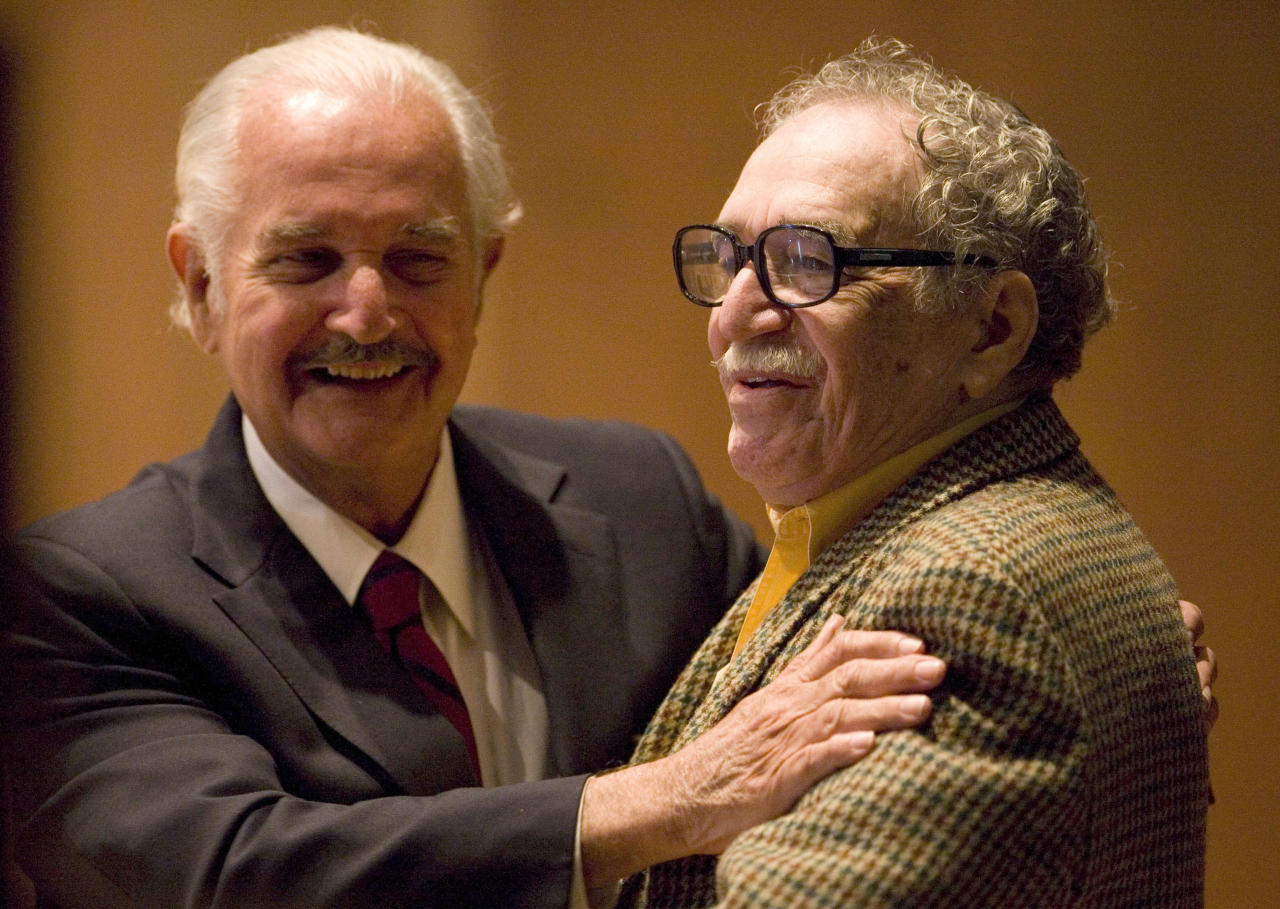 FILE - In this Nov. 18, 2008 file photo, Mexican writer Carlos Fuentes, left, embraces Colombian author Gabriel Garcia Marquez during a round table discussion on Fuentes' work at the UNAM national university in Mexico City. Fuentes, Mexico's most celebrated novelist and among Latin America's most prominent authors, died on May 15, 2012 He was 83.(AP Photo/Dario Lopez-Mills, File)