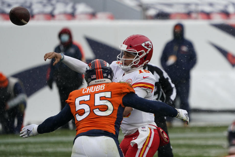 Kansas City Chiefs quarterback Patrick Mahomes throws a pass under pressure from Denver Broncos outside linebacker Bradley Chubb (55) during the first half of an NFL football game Sunday, Oct. 25, 2020, in Denver. (AP Photo/Jack Dempsey)