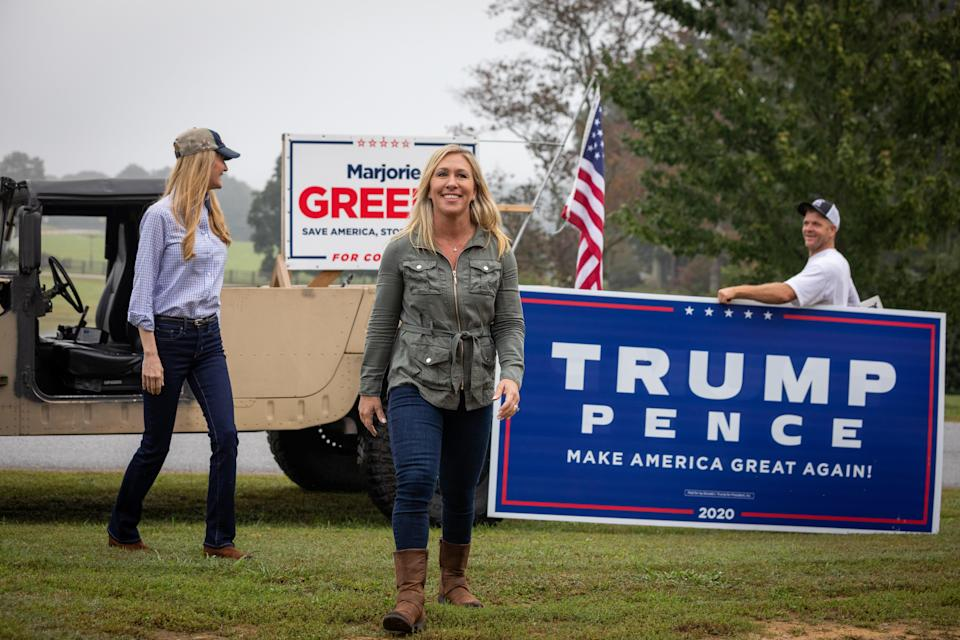 DALLAS, GA - OCTOBER 15: Georgia Republican House candidate Marjorie Taylor Greene (C) and Sen. Kelly Loeffler (R-GA) (L) arrive at a press conference in a Humvee during which Greene endorsed Loeffler on October 15, 2020 in Dallas, Georgia. Greene has been the subject of some controversy recently due to her support for the right-wing conspiracy group QAnon. (Photo by Dustin Chambers/Getty Images)
