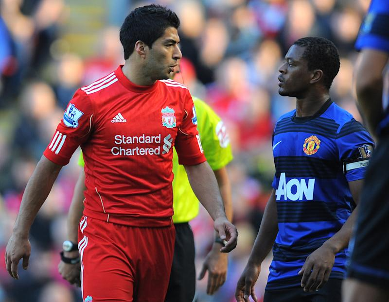 Luis Suarez and Patrice Evra's infamous row (ANDREW YATES/AFP/Getty Images)