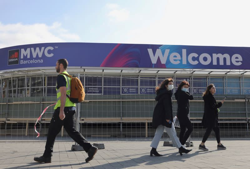 FILE PHOTO: Employees pass by Fira de Barcelona after the Mobile World Congress (MWC) was cancelled in Barcelona