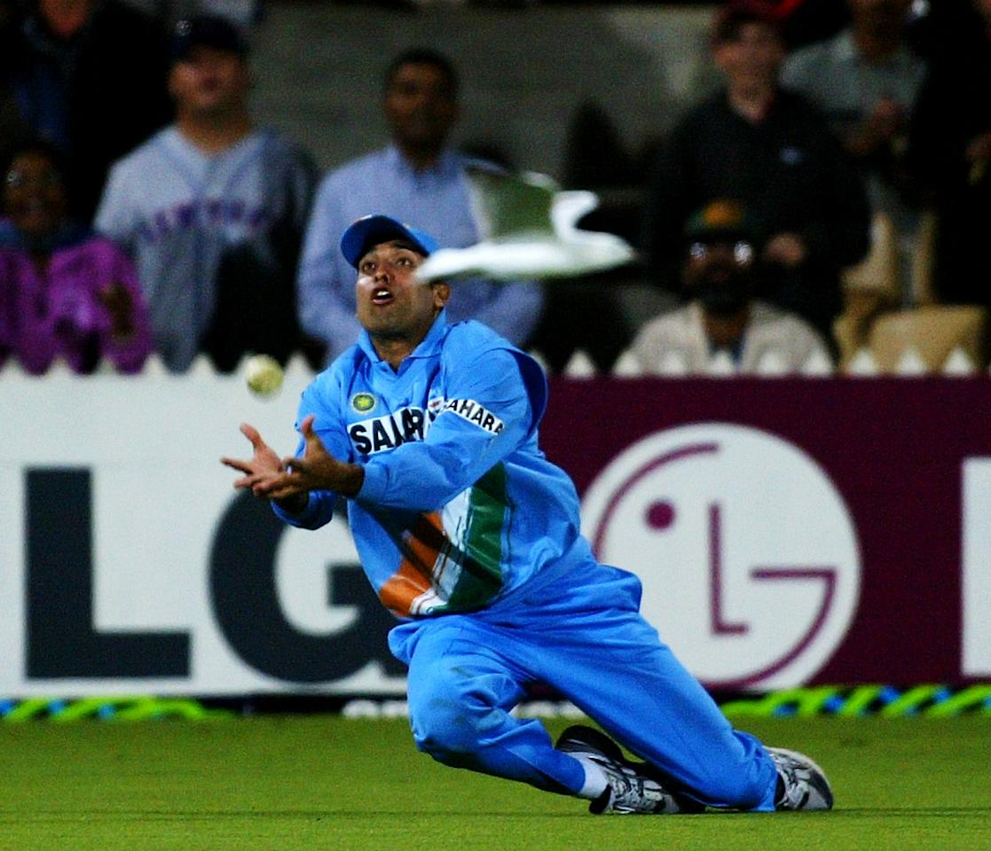 ADELAIDE, AUSTRALIA - JANUARY 24:  VVS Laxman of India catches Andy Blignaut of Zimbabwe during the VB Series One Day International between India and Zimbabwe at The Adelaide Oval on January 24, 2004 in Adelaide, Australia. (Photo by Hamish Blair/Getty Images)