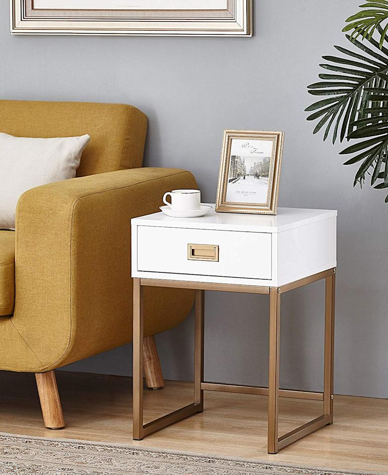 """<p>We're into the gold details on this <a href=""""https://www.popsugar.com/buy/Modern-Nightstand-Side-End-Table-500970?p_name=Modern%20Nightstand%20Side%20End%20Table&retailer=amazon.com&pid=500970&price=62&evar1=casa%3Aus&evar9=45735037&evar98=https%3A%2F%2Fwww.popsugar.com%2Fphoto-gallery%2F45735037%2Fimage%2F46754840%2FModern-Nightstand-Side-End-Table&list1=shopping%2Camazon%2Chome%20decor%2Cfurniture%2Chome%20shopping&prop13=api&pdata=1"""" rel=""""nofollow"""" data-shoppable-link=""""1"""" target=""""_blank"""" class=""""ga-track"""" data-ga-category=""""Related"""" data-ga-label=""""https://www.amazon.com/Golden-Finish-Modern-Nightstand-Drawer/dp/B0765PC92W/ref=sr_1_64?keywords=nightstand+under+%24200&amp;qid=1570829861&amp;sr=8-64"""" data-ga-action=""""In-Line Links"""">Modern Nightstand Side End Table</a> ($62).</p>"""