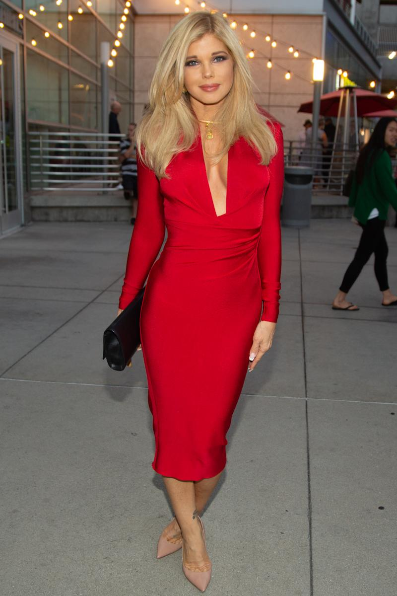 """Donna D'Errico arrives for the LA Premiere Of """"Low Low"""" at ArcLight Hollywood on August 15, 2019 in Hollywood, California in a red tight dress"""
