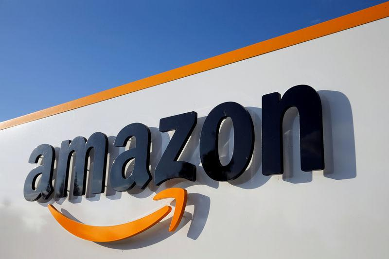 FILE PHOTO: Amazon's logo at its logistics centre in Boves, France