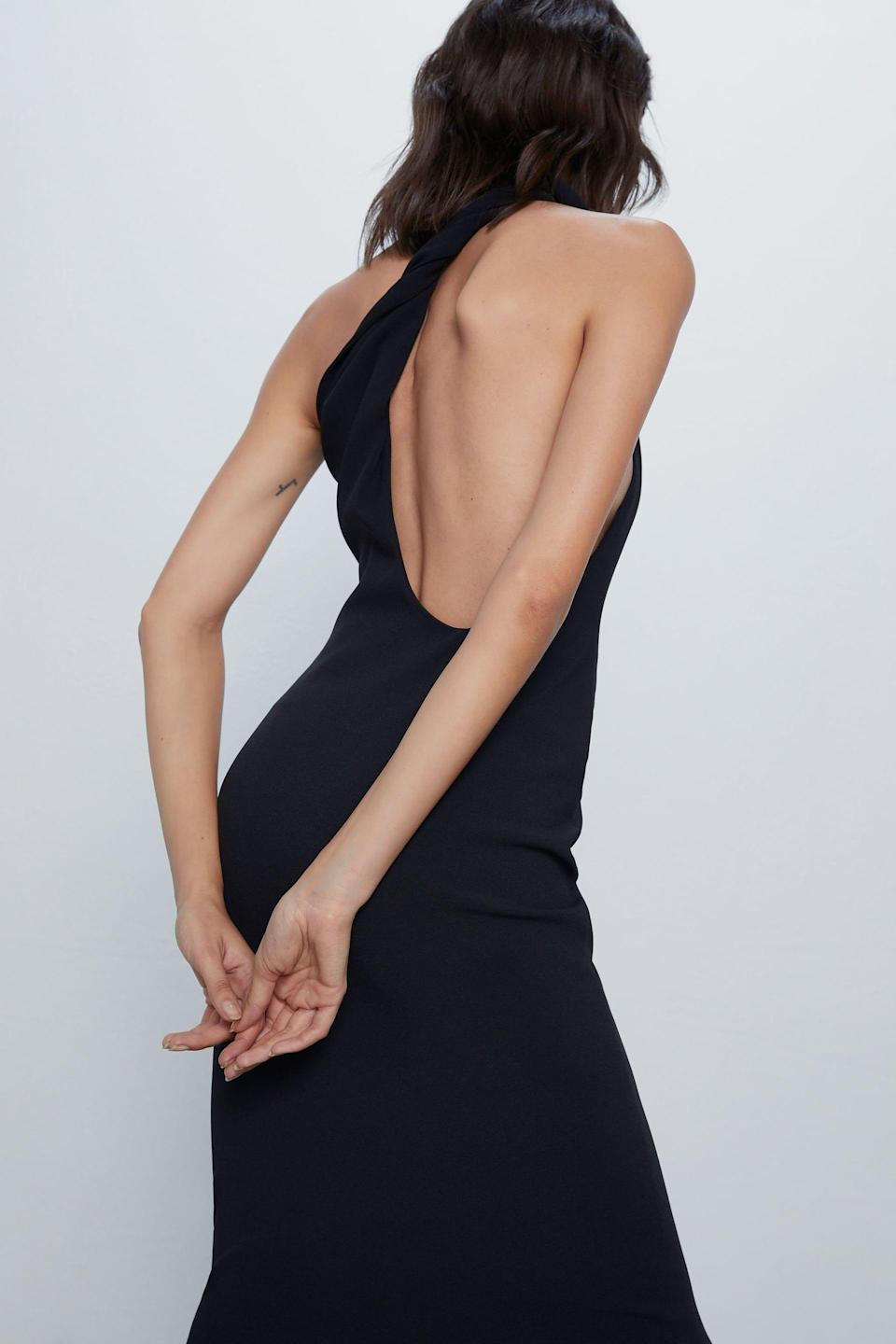 """<p><strong>ZARA</strong></p><p>zara.com</p><p><strong>$69.90</strong></p><p><a href=""""https://www.zara.com/us/en/asymmetrical-slip-dress-p02393307.html"""" rel=""""nofollow noopener"""" target=""""_blank"""" data-ylk=""""slk:SHOP IT"""" class=""""link rapid-noclick-resp"""">SHOP IT</a></p><p>This open-back, asymmetrical dress has me drooling. It's a sleek and sexy way to update your LBD collection and add some edge without trying too hard. </p>"""