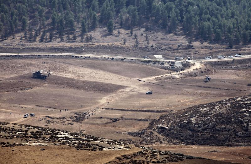 Israeli Army vehicles and helicopters are seen in an open area as they search for the remains of a drone in the Negev southern Israel, Saturday, Oct. 6, 2012. Israeli jets scrambled to intercept a drone that crossed into Israeli airspace Saturday from the Mediterranean Sea, bringing it down without incident in the south of the country, a military spokeswoman said. (AP Photo/Yehuda Lachiani) ISRAEL OUT