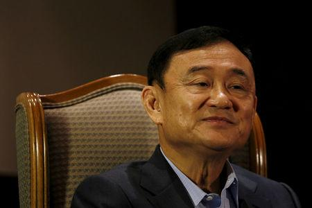 Former Thai Prime Minister Thaksin Shinawatra speaks to Reuters during an interview in Singapore