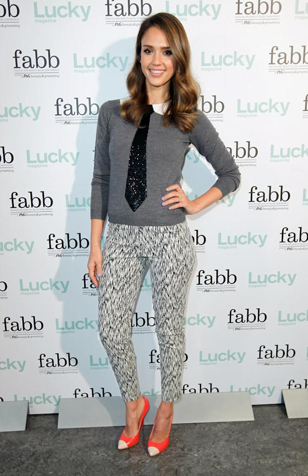 "Jessica Alba was all smiles as she arrived at a <i>Lucky</i> magazine event on Monday evening. The fashion-forward actress -- who tends to impress on the red carpet -- paired printed Topshop pants and colorful cap-toe heels with a menswear-inspired Alice + Olivia sweater, which featured a sequined tie. Wavy tresses and lavender nail polish completed Alba's quirky yet super cute look. (4/30/2012)<br><br><a target=""_blank"" href=""http://bit.ly/lifeontheMlist"">Follow 2 Hot 2 Handle creator, Matt Whitfield, on Twitter!</a>"