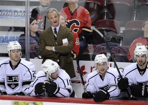 Los Angeles Kings head coach Darryl Sutter stands behind the bench during NHL hockey action against the Calgary Flames, in Calgary, Alberta, Saturday, Jan. 14, 2012. (AP Photo/The Canadian Press, Larry MacDougal)