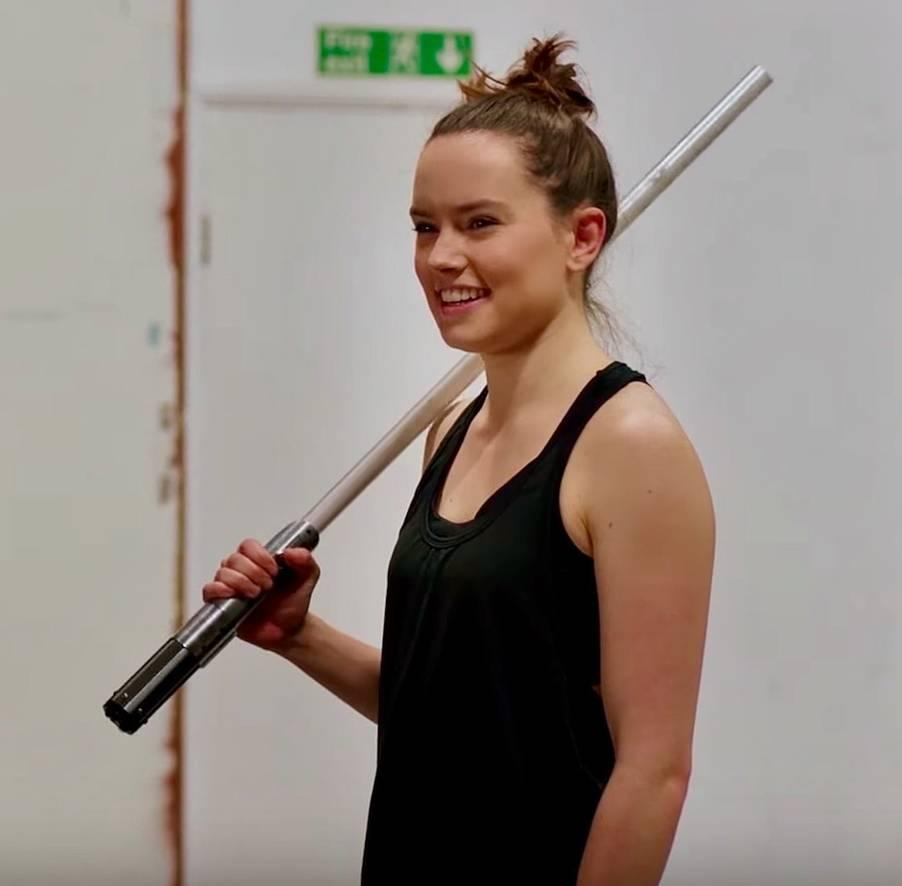 Daisy Ridley training with a lightsaber (Credit: Disney)