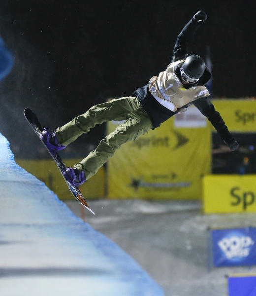 Kelly Clark, of the United States, lands a trick on her first run during the World Cup U.S. Grand Prix halfpipe snowboarding finals, Saturday, Dec. 21, 2013, in Frisco, Colo. Clark took first place in the event. (AP Photo/Julie Jacobson)