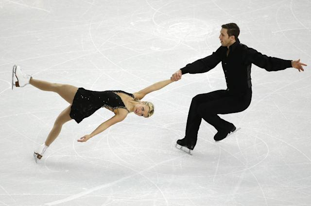 Kirsten Moore-Towers and Dylan Moscovitch of Canada compete in the team pairs free skate figure skating competition at the Iceberg Skating Palace during the 2014 Winter Olympics, Saturday, Feb. 8, 2014, in Sochi, Russia. (AP Photo/Bernat Armangue)