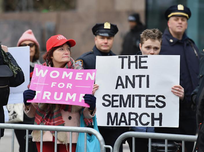 Counter-protesters hold signs as people march during the Women's Unity Rally at Foley Square on Jan. 19, 2019 in New York City. (Photo: Angela Weiss /AFP/Getty Images)