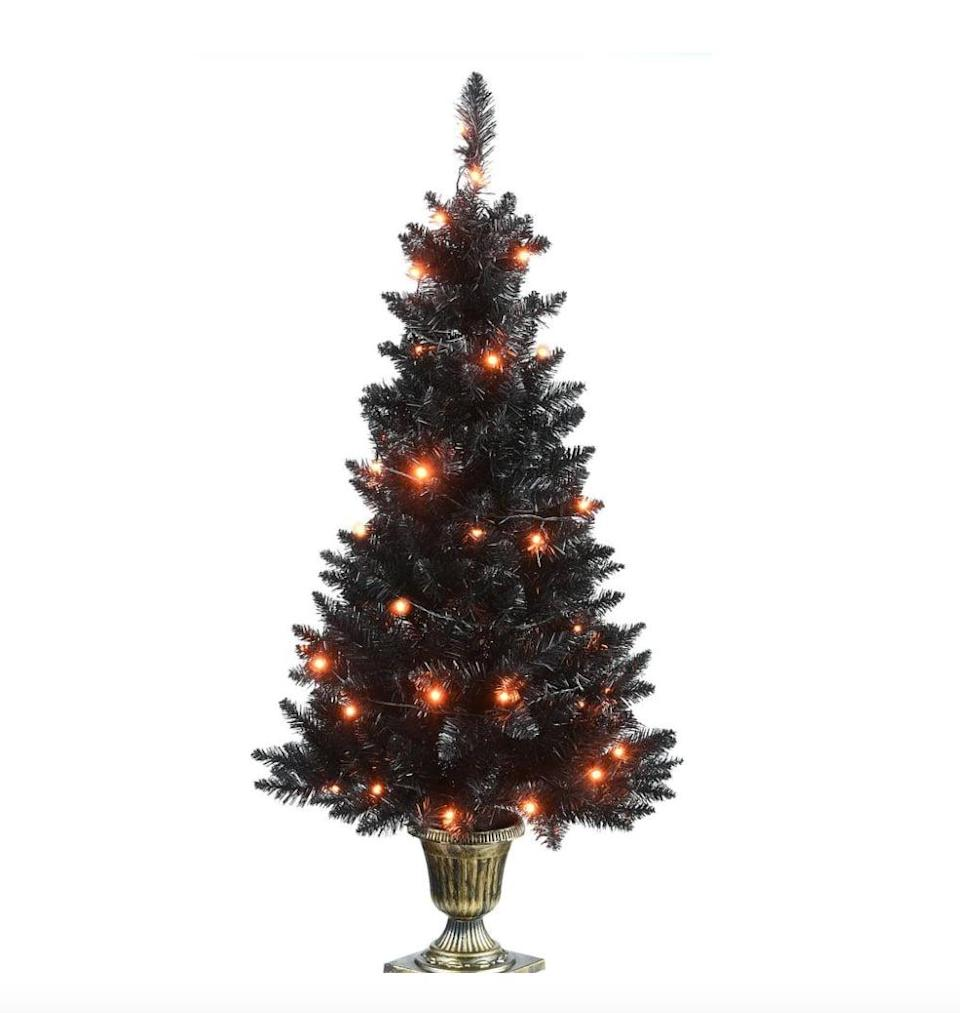 """<p>Why wait until Christmas to put up a tree when you can display a <span>Black Entrance Tree with String of Orange Lights</span> ($60) now? Suited for indoors or covered outdoor settings, the remote-controlled <a class=""""link rapid-noclick-resp"""" href=""""https://www.popsugar.com/Halloween"""" rel=""""nofollow noopener"""" target=""""_blank"""" data-ylk=""""slk:Halloween"""">Halloween</a> tree includes eight different light functions. </p>"""