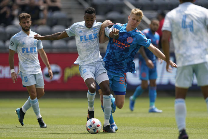 Los Angeles FC midfielder Mark-Anthony Kaye, center left, and New York City FC midfielder Keaton Parks (55) battle for control of the ball during the first half of an MLS soccer game Saturday, May 29, 2021, in Los Angeles. (AP Photo/Ashley Landis)
