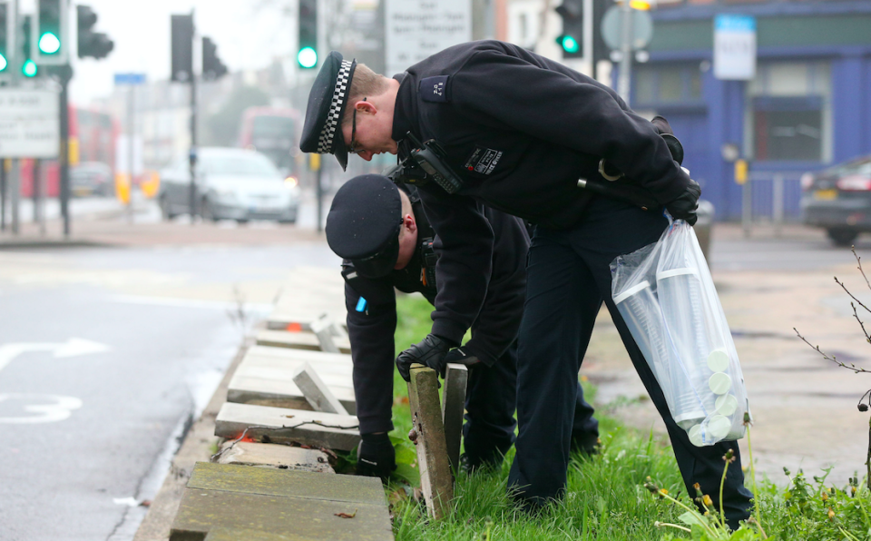 <em>Officers in Thorton Heath, south London, search for weapons (PA)</em>