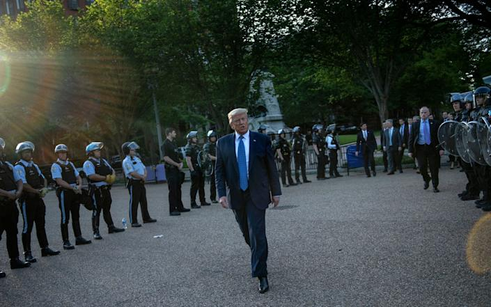 Police clear path through BLM protests for Trump at Lafayette Park in Washington, so he can do photocall at St John's church June 1, 2020 - Brendan Smialowski/AFP