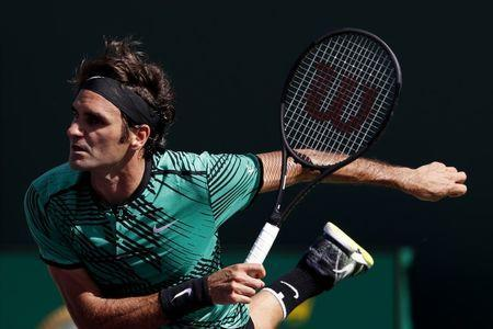 Mar 27, 2017; Miami, FL, USA; Roger Federer of Switzerland serves against Juan Martin del Potro of Argentina (not pictured) on day seven of the 2017 Miami Open at Crandon Park Tennis Center. Mandatory Credit: Geoff Burke-USA TODAY Sports