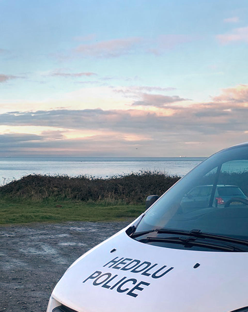 A handout photo taken from the Facebook page of NWP Anglesey of emergency services near Anglesey after reports of an aircraft crash off the North Wales coast. (PA)