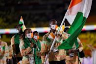 <p>Ivory Coast's flag bearers Marie-Josee Ta Lou (L) and bearer Cheick Sallah Cisse lead their delegation as they parade during the opening ceremony of the Tokyo 2020 Olympic Games, at the Olympic Stadium, in Tokyo, on July 23, 2021. (Photo by Odd ANDERSEN / AFP) (Photo by ODD ANDERSEN/AFP via Getty Images)</p>