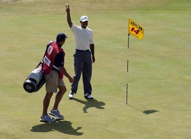 """<h1 class=""""title"""">Golf - The 135th Open Championship 2006 - Day Two - Royal Liverpool - Hoylake</h1> <div class=""""caption""""> USA's Tiger Woods retrieves his ball from the 14th hole after making eagle during the second round of the 135th Open Championship at Royal Liverpool Golf Club, Hoylake. (Photo by Rebecca Naden - PA Images/PA Images via Getty Images) </div> <cite class=""""credit"""">Rebecca Naden - PA Images</cite>"""
