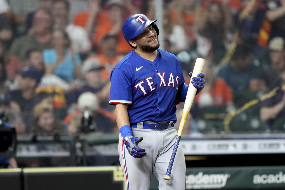 Texas Rangers' Jose Trevino reacts after striking out against the Houston Astros during the seventh inning of a baseball game Thursday, May 13, 2021, in Houston. (AP Photo/David J. Phillip)