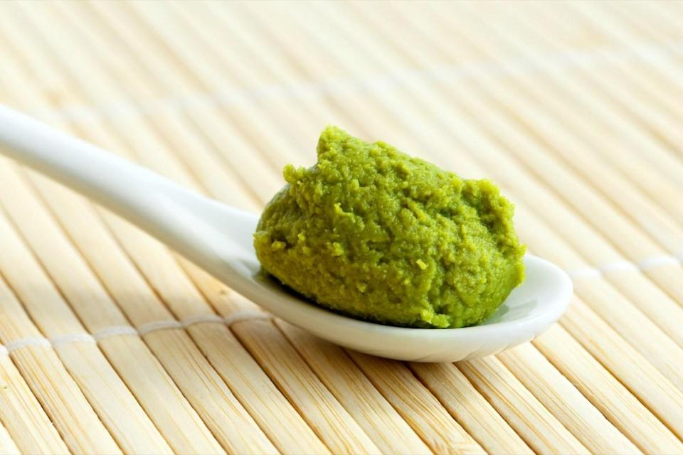 """Plenty of people like to enjoy a little wasabi with their sushi—or a lot, depending on their tolerance for the stuff. But it turns out that real <a href=""""https://www.bbc.com/news/business-29082091"""" rel=""""nofollow noopener"""" target=""""_blank"""" data-ylk=""""slk:wasabi is pretty pricey"""" class=""""link rapid-noclick-resp"""">wasabi is pretty pricey</a> (around $160 per kilogram), which is why 99 percent of what's called wasabi in the U.S. is actually a <a href=""""https://www.theatlantic.com/video/index/585172/wasabi-fake/"""" rel=""""nofollow noopener"""" target=""""_blank"""" data-ylk=""""slk:mix of horseradish and hot Chinese mustard"""" class=""""link rapid-noclick-resp"""">mix of horseradish and hot Chinese mustard</a>, plus green dye to give it the right color, according to a report published in <em>The Atlantic</em>."""