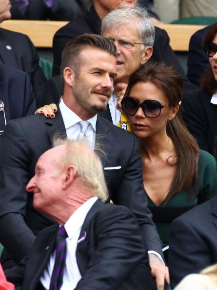 David Beckham and Victoria Beckham sit in the Royal Box during the Gentlemen's Singles final match between Roger Federer of Switzerland and Andy Murray of Great Britain on day thirteen of the Wimbledon Lawn Tennis Championships at the All England Lawn Tennis and Croquet Club on July 8, 2012 in London, England. (Photo by Clive Brunskill/Getty Images)