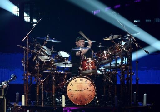 Neil Peart performs for Rush's induction to the  Rock and Roll Hall of Fame, in Los Angeles April 2013