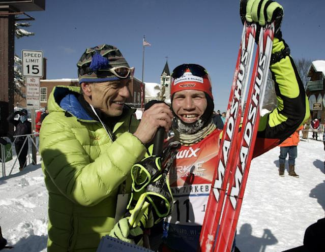 Tom Reichelt, right, of Germany, smiles after winning the men's skate division at the American Birkebeiner, in Hayward, Wis., on Saturday, Feb. 22, 2014. Reichelt had a time of 2 hours, 14 minutes, 29.9 second. (AP Photo/Paul M. Walsh)