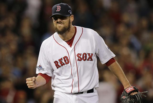 Boston Red Sox starting pitcher John Lackey clenches his fist after striking out Tampa Bay Rays' Ben Zobrist to end the top of the fifth inning of Game 2 of baseball's American League division series, Saturday, Oct. 5, 2013, in Boston. (AP Photo/Charles Krupa)
