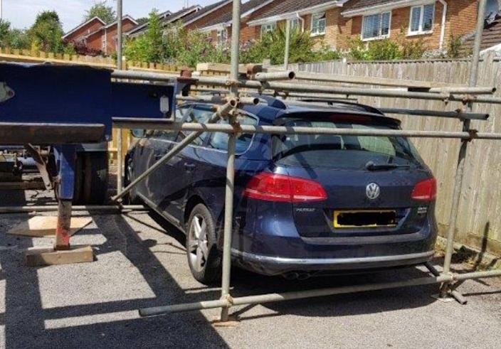 A local policeman shared pictures of a car blocked in with scaffolding as a result of a neighbourhood row. (Twitter/Inspector Darren)