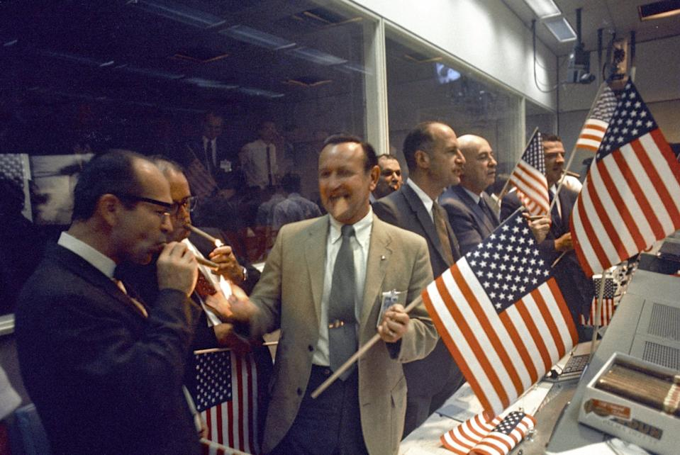 NASA and Manned Spacecraft Center (MSC) officials join the flight controllers in celebrating the conclusion of the Apollo 11 mission on July 24, 1969. From left foreground Dr. Maxime A. Faget, MSC Director of Engineering and Development; George S. Trimble, MSC Deputy Director; Dr. Christopher C. Kraft Jr., MSC Director fo Flight Operations; Julian Scheer (in back), Assistant Adminstrator, Office of Public Affairs, NASA HQ.; George M. Low, Manager, Apollo Spacecraft Program, MSC; Dr. Robert R. Gilruth, MSC Director; and Charles W. Mathews, Deputy Associate Administrator, Office of Manned Space Flight, NASA HQ. (Photo: NASA)