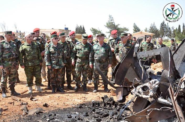 A handout picture released by the official Syrian Arab News Agency (SANA) on April 7, 2017, reportedly shows Syrian Armed Forces' chief of staff, Ali Abdullah Ayyoub (C-L), visiting Shayrat airfield (AFP Photo/HO)